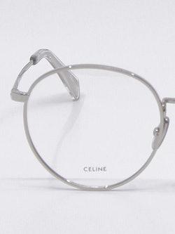 Nærbilde av rund metallbrille i sølv fra Celine